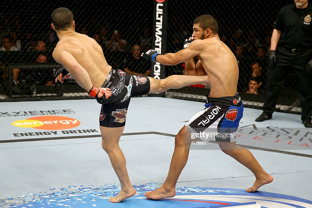 John Makdessi kicks Renee Forte in their UFC lightweight bout at the Air Canada Center on September 21, 2013 in Toronto, Ontario, Canada.