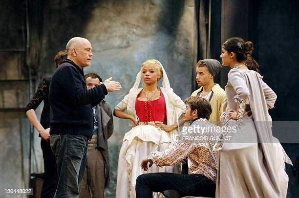 US John Malkovich briefs actors Jina Djemba Yannick Landrein Mabo Kouyate and Pauline Moulene during the photocall of his theatre play 'Les liaisons...