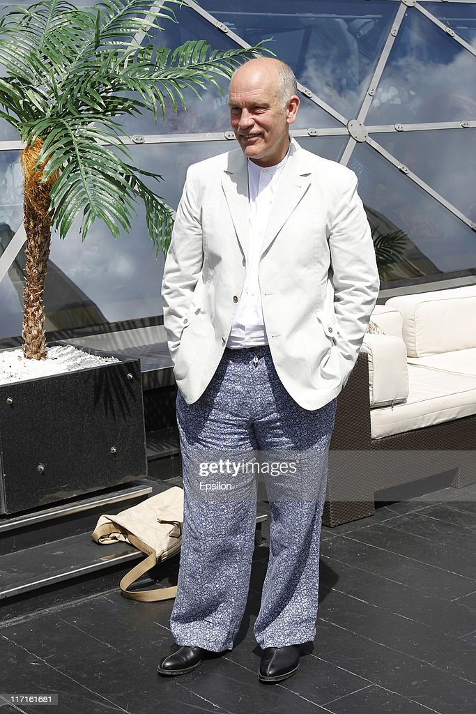 John Malkovich poses for a photocall before global premiere of 'Transformers 3' movie on the roof of the Ritz hotel on June 23, 2011 in Moscow, Russia.