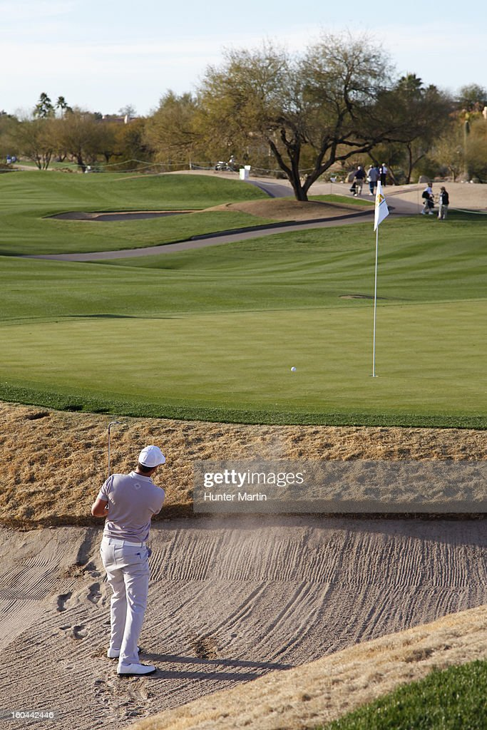 John Mallinger hits his third shot on the ninth hole during the first round of the Waste Management Phoenix Open at TPC Scottsdale on January 31, 2013 in Scottsdale, Arizona.