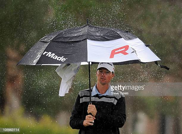 John Mallinger shakes the water off of his umbrella on the 7th hole during the second round of the Justin Timberlake Shriners Hospitals for Children...