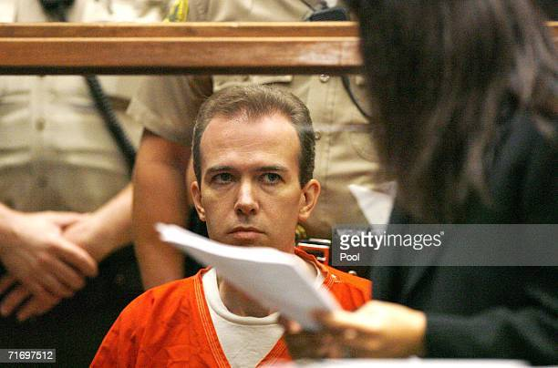 John Mark Karr the suspect in the killing of child beauty queen JonBenet Ramsey looks at deputy public defender Haydeh Takasugi during an extradition...