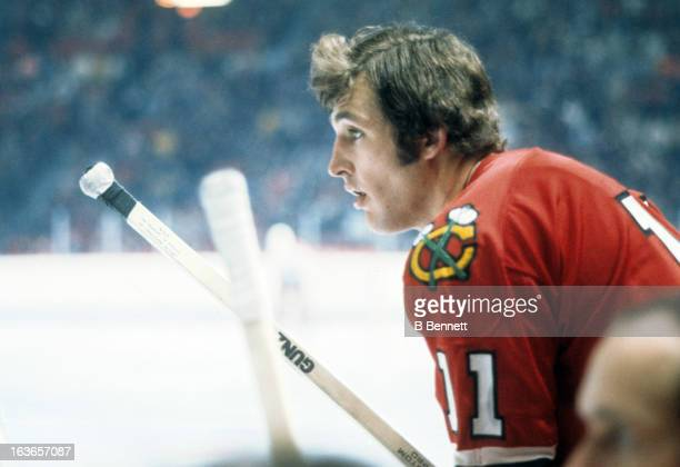 John Marks of the Chicago Blackhawks leans on the boards during warmups before an NHL game against the Montreal Canadiens circa 1975 at the Montreal...