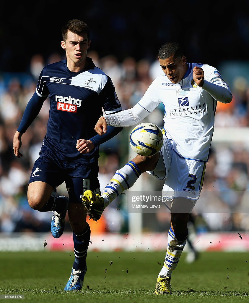 John Marquis of Millwall and <a gi-track='captionPersonalityLinkClicked' href=/galleries/search?phrase=Lee+Peltier&family=editorial&specificpeople=1007594 ng-click='$event.stopPropagation()'>Lee Peltier</a> of Leeds challenge for the ball during the npower Championship match between Leeds United and Millwall at Elland Road on March 2, 2013 in Leeds, England.
