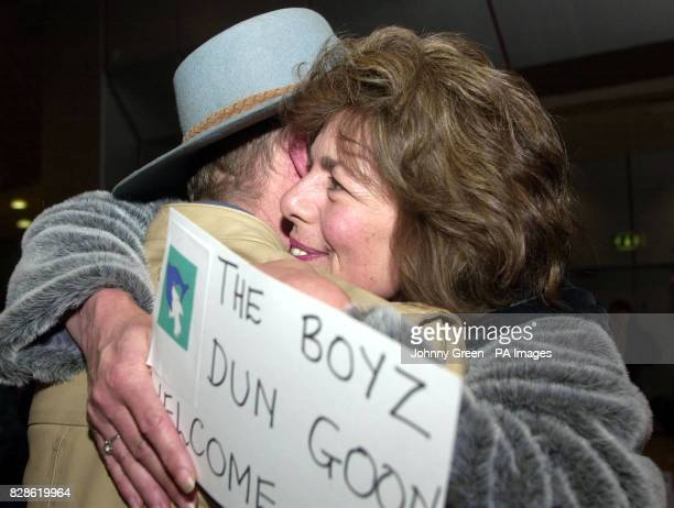 John Maughan and a singer from Cornwall is greeted by his wife at Heathrow Airport outside London after aiding David Haplin from Haytor Devon who put...