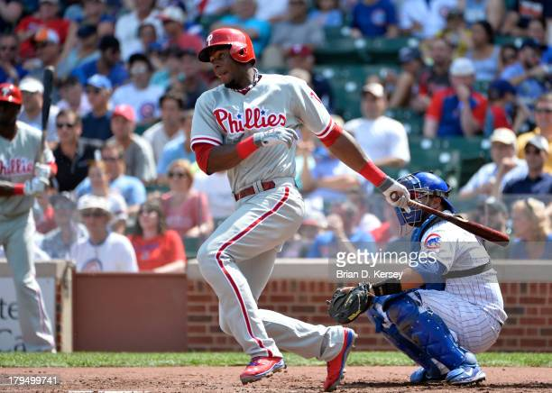 John Mayberry Jr #15 of the Philadelphia Phillies bats during the second inning at Wrigley Field on August 30 2013 in Chicago Illinois The Phillies...