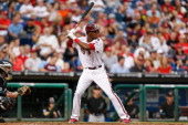 John Mayberry Jr #15 of the Philadelphia Phillies bats during the game against the Arizona Diamondbacks at Citizens Bank Park on August 23 2013 in...