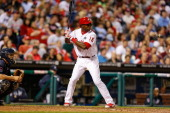 John Mayberry Jr #15 of the Philadelphia Phillies bats during the game against the Atlanta Braves at Citizens Bank Park on April 14 2014 in...