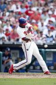 John Mayberry Jr #15 of the Philadelphia Phillies bats during the game against the Atlanta Braves at Citizens Bank Park on June 28 2014 in...