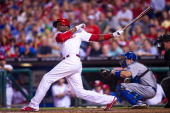 John Mayberry Jr #15 of the Philadelphia Phillies bats during the game against the Los Angeles Dodgers at Citizens Bank Park on August 16 2013 in...