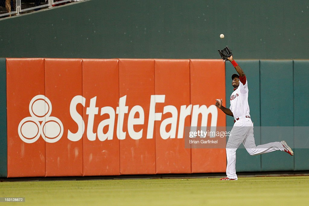 John Mayberry Jr. #15 of the Philadelphia Phillies catches the ball during the game against the Colorado Rockies at Citizens Bank Park on September 7, 2012 in Philadelphia, Pennsylvania. The Phillies won 3-2.