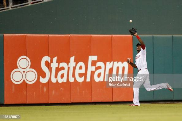 John Mayberry Jr #15 of the Philadelphia Phillies catches the ball during the game against the Colorado Rockies at Citizens Bank Park on September 7...