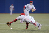 John Mayberry Jr #15 of the Philadelphia Phillies dives but cannot get to a single in the third inning during MLB game action by Colby Rasmus of the...