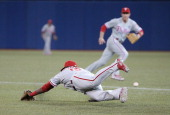 John Mayberry Jr #15 of the Philadelphia Phillies dives but cannot get to a single in the third inning as Chase Utley breaks for the ball during MLB...