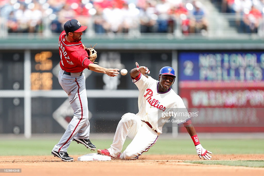 John Mayberry Jr. #15 of the Philadelphia Phillies grimaces as he is forced out at second during the game against the Washington Nationals at Citizens Bank Park on August 26, 2012 in Philadelphia, Pennsylvania. The Phillies won 4-1.