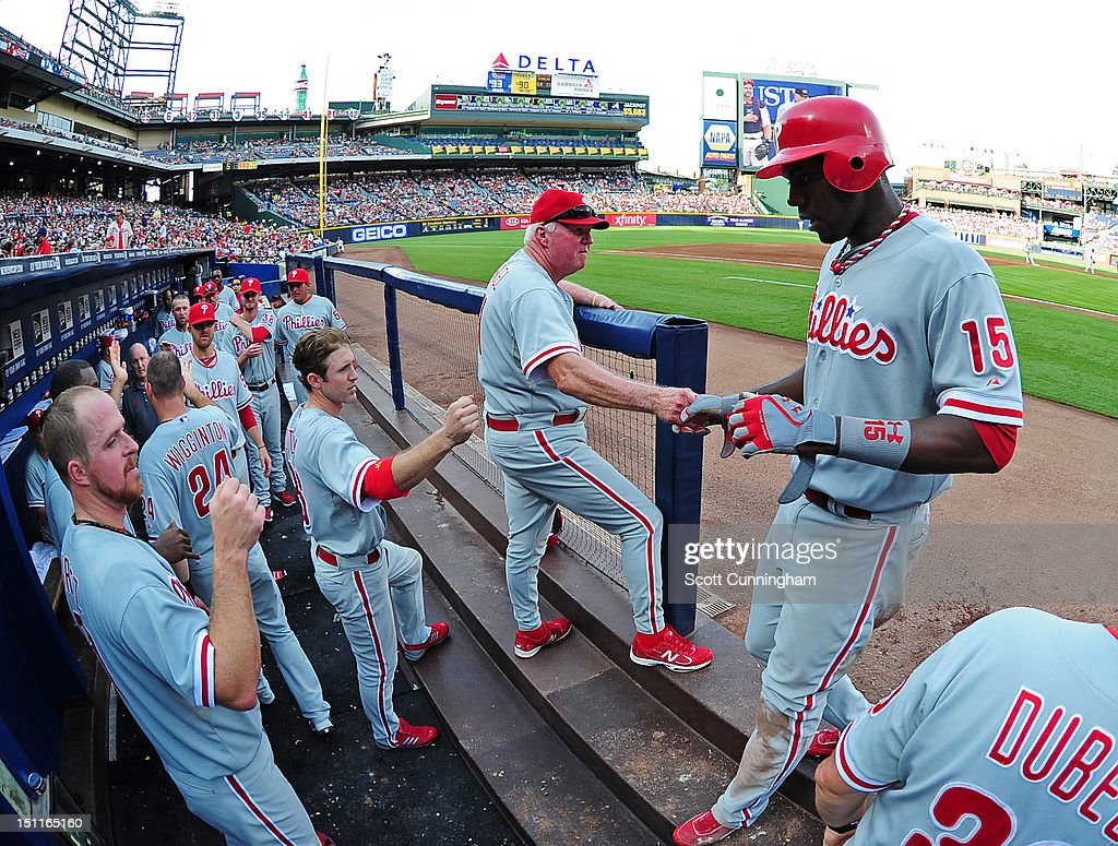 John Mayberry Jr. #15 of the Philadelphia Phillies is congratulated by teammates after scoring against the Atlanta Braves at Turner Field on September 2 2012 in Atlanta, Georgia.