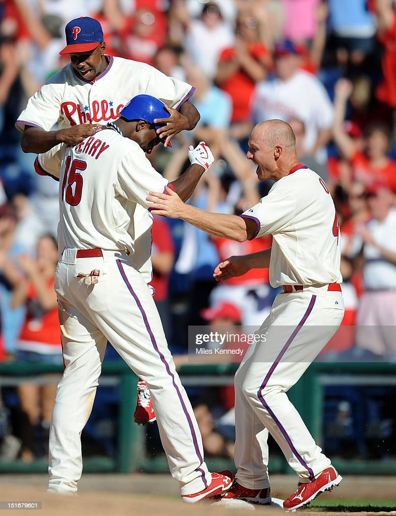John Mayberry Jr. #15 of the Philadelphia Phillies is congratulated by Juan Pierre #10 and Pete Orr # 4 after hitting a walk off single against the Colorado Rockies during the ninth inning on September 9, 2012 at Citizens Bank Park in Philadelphia, Pennsylvania. The Phillies won 3-2.