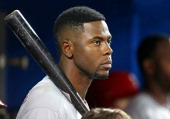 John Mayberry Jr #15 of the Philadelphia Phillies looks on from the dugout during MLB game action against the Toronto Blue Jays on May 7 2014 at...
