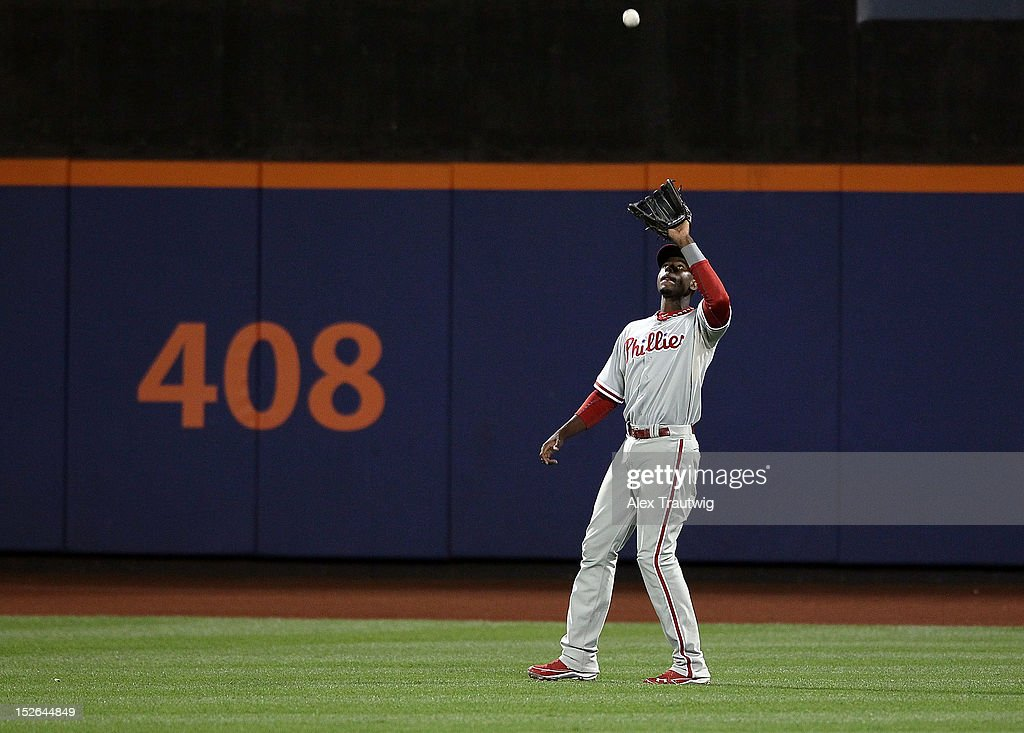 John Mayberry Jr. #15 of the Philadelphia Phillies makes a catch against the New York Mets at Citi Field on September 20, 2012 in the Flushing neighborhood of the Queens borough of New York City.