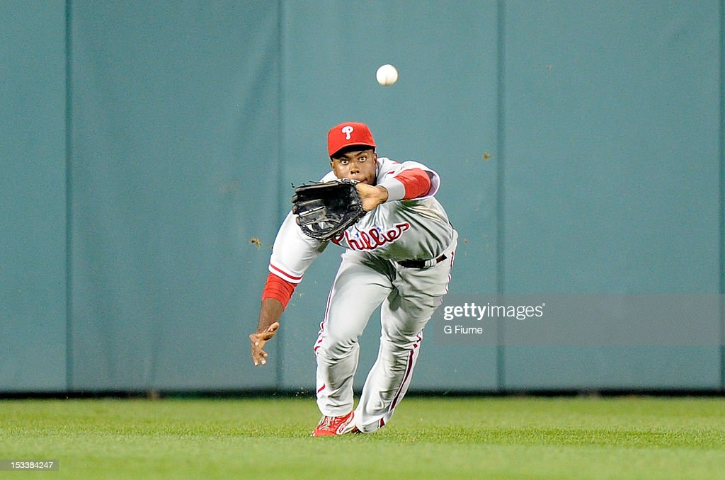 John Mayberry Jr. #15 of the Philadelphia Phillies makes a diving catch against the Washington Nationals at Nationals Park on October 1, 2012 in Washington, DC.
