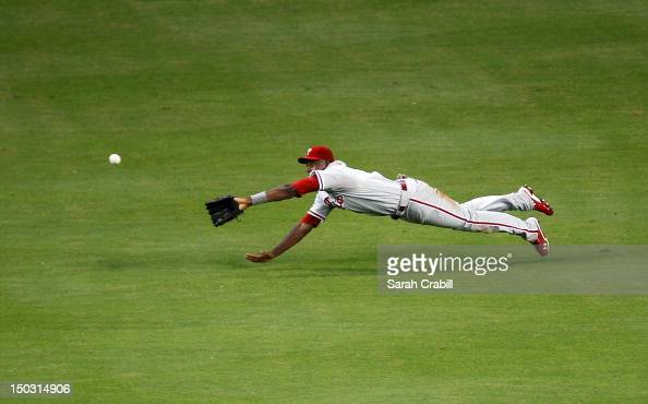 John Mayberry Jr #15 of the Philadelphia Phillies misses a catch during a game against the Miami Marlins at Marlins Park on August 15 2012 in Miami...