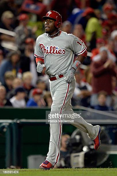 John Mayberry Jr #15 of the Philadelphia Phillies runs toward home plate after hitting a solo home run in the fifth inning against the Washington...