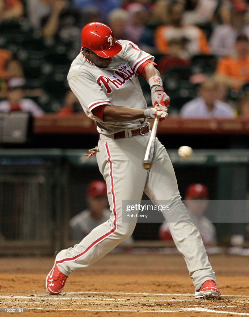 John Mayberry Jr. #15 of the Philadelphia Phillies singles in the first inning against the Houston Astros scoring Ryan Howard #6 of the Philadelphia Phillies at Minute Maid Park on September 14, 2012 in Houston, Texas.