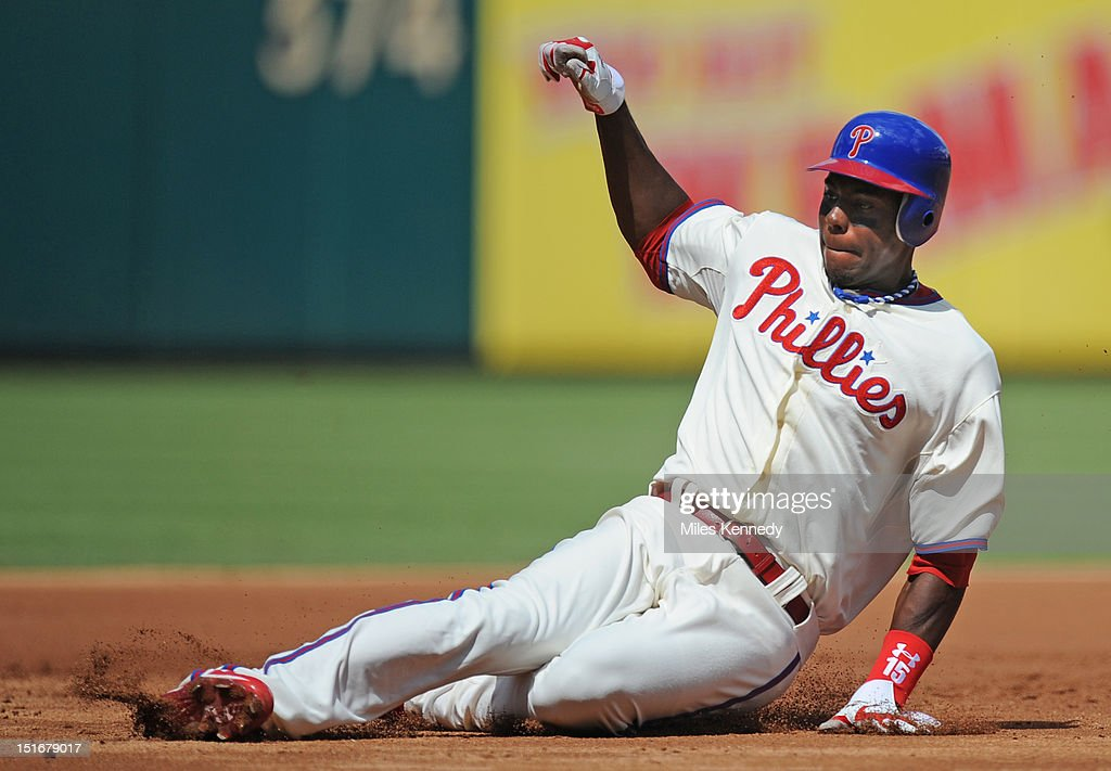 John Mayberry Jr. #15 of the Philadelphia Phillies slides into third base against the Colorado Rockies during the first inning on September 9, 2012 at Citizens Bank Park in Philadelphia, Pennsylvania. The Phillies won 3-2.