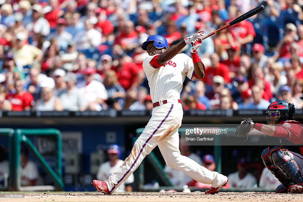 John Mayberry Jr. #15 of the Philadelphia Phillies swings at a pitch during the game against the Washington Nationals at Citizens Bank Park on August 26, 2012 in Philadelphia, Pennsylvania. The Phillies won 4-1.