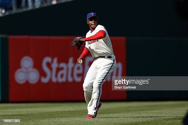 John Mayberry Jr #15 of the Philadelphia Phillies throws the ball infield during the game against the Kansas City Royals at Citizens Bank Park on...