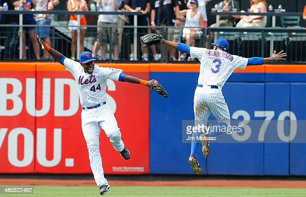 John Mayberry Jr #44 and Curtis Granderson of the New York Mets celebrate after defeating the Arizona Diamondbacks at Citi Field on July 12 2015 in...