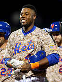 John Mayberry Jr #44 of the New York Mets celebrates after he drove in the game winning run in the bottom of the 14th inning against the St Louis...
