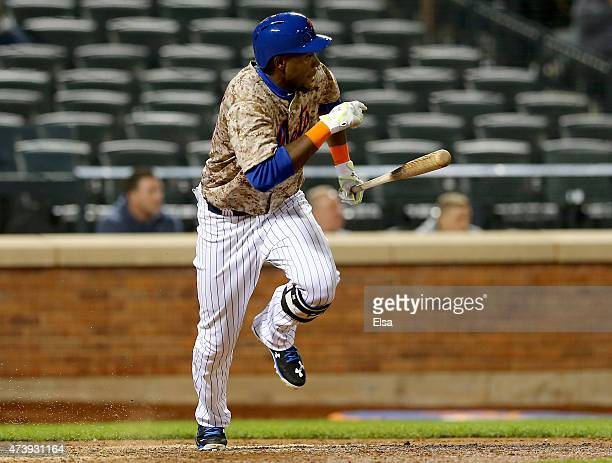 John Mayberry Jr #44 of the New York Mets drives in the game winning run in the bottom of the 14th inning against the St Louis Cardinals on May 18...