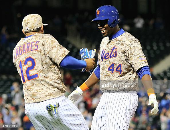 John Mayberry Jr #44 of the New York Mets is congratulated by uan Lagares after Mayberry Jr drove in the game winning run in the bottom of the 14th...
