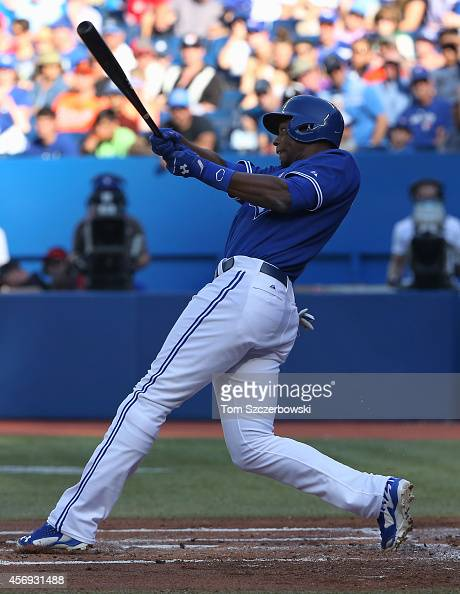 John Mayberry Jr #9 of the Toronto Blue Jays bats during MLB game action against the Baltimore Orioles on September 27 2014 at Rogers Centre in...