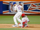John Mayberry Jr#15 of the Philadelphia Phillies is forced out at second base by Daniel Murphy of the New York Mets in the ninth inning during the...