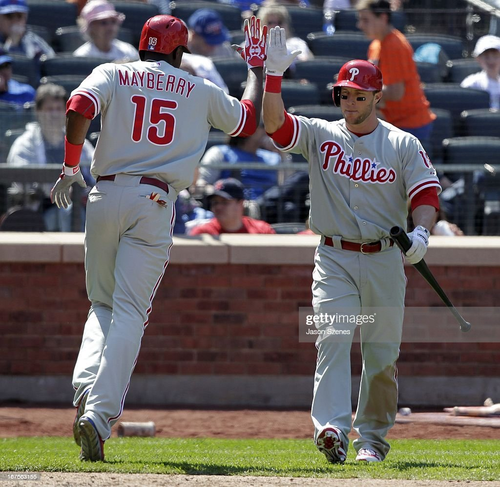John Mayberry #15 of the Philadelphia Phillies (L) celebrates his solo home run with teammate <a gi-track='captionPersonalityLinkClicked' href=/galleries/search?phrase=Laynce+Nix&family=editorial&specificpeople=214636 ng-click='$event.stopPropagation()'>Laynce Nix</a> in the fifth inning against the New York Mets at Citi Field on April 27, 2013 in the Flushing neighborhood of the Queens borough of New York City. (Photo by Jason Szenes/Getty Images