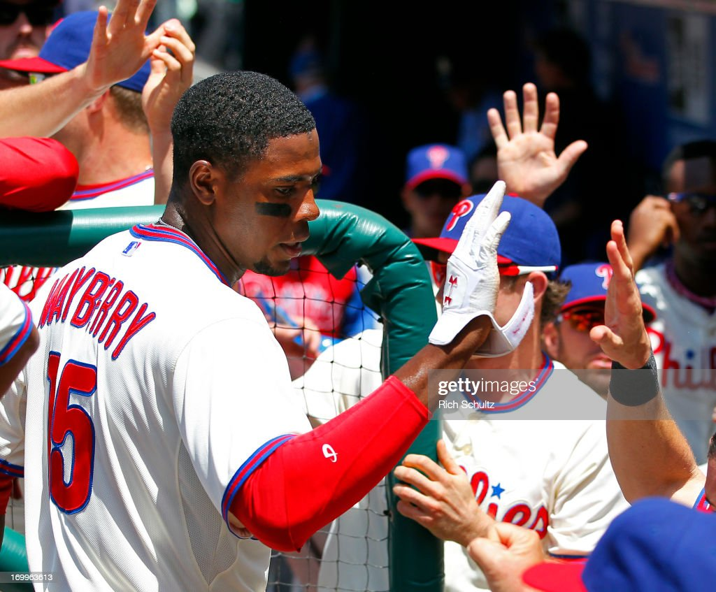 John Mayberry #15 of the Philadelphia Phillies is congratulated by teammates after scoring on a double by Erik Kratz #31during the second inning against the Miami Marlins on June 5, 2013 at Citizens Bank Park in Philadelphia, Pennsylvania.