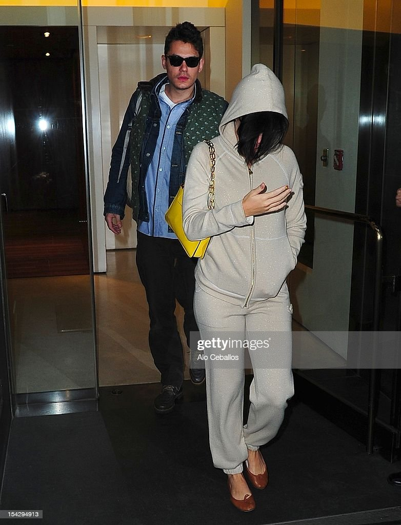John Mayer and Katy Perry are seen leaving an apartment building in Soho on the streets of Manhattan on October 17, 2012 in New York City.