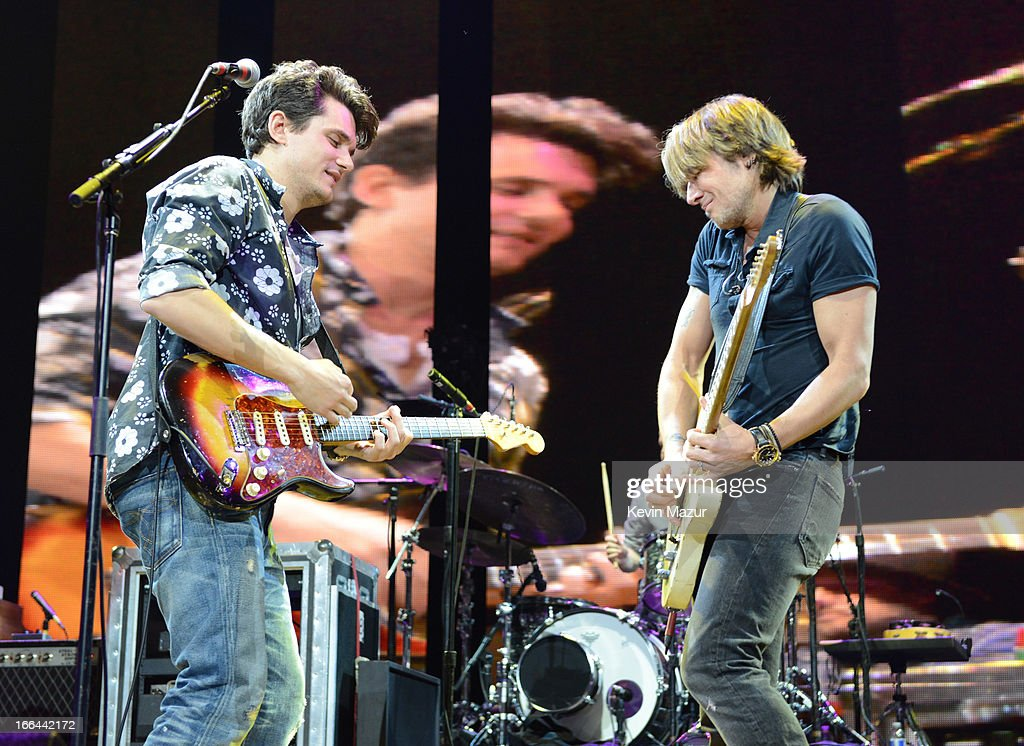John Mayer and Keith Urban perform on stage during the 2013 Crossroads Guitar Festival at Madison Square Garden on April 12, 2013 in New York City.