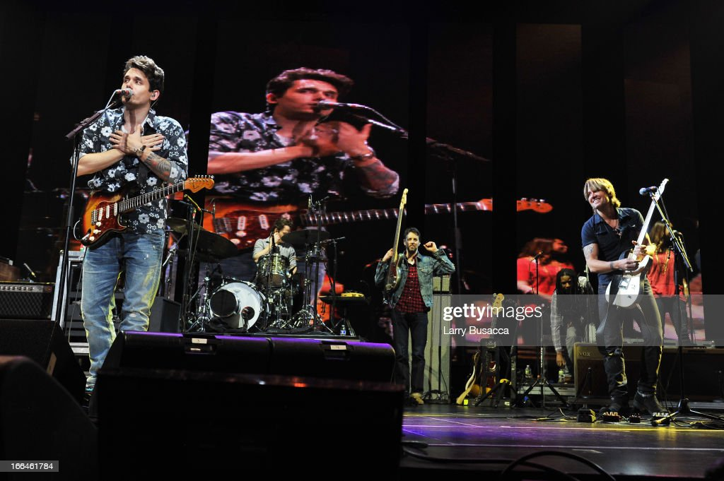 John Mayer (L) and Keith Urban perform on stage during the 2013 Crossroads Guitar Festival at Madison Square Garden on April 12, 2013 in New York City.