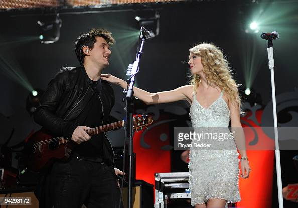 John Mayer and Taylor Swift perform onstage during Z100's Jingle Ball 2009 at Madison Square Garden on December 11 2009 in New York City