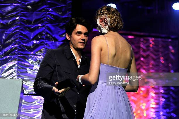 John Mayer and Taylor Swift speak onstage during the 41st Annual Songwriters Hall of Fame Ceremony at The New York Marriott Marquis on June 17 2010...