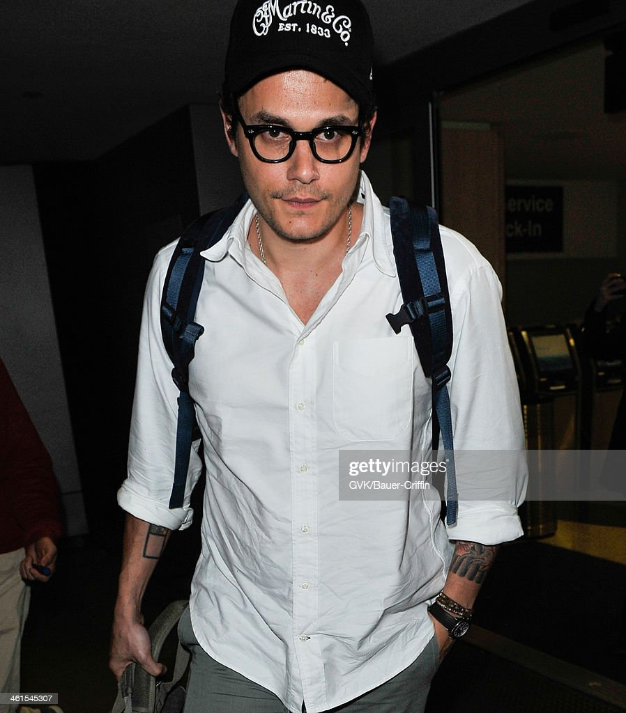John Mayer is seen at LAX airport on January 08, 2014 in Los Angeles, California.