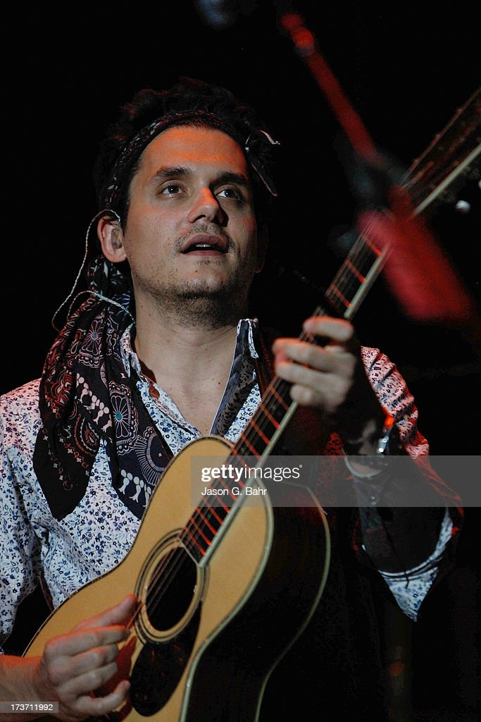 <a gi-track='captionPersonalityLinkClicked' href=/galleries/search?phrase=John+Mayer&family=editorial&specificpeople=201930 ng-click='$event.stopPropagation()'>John Mayer</a> opens his concert with a classical guitar at Red Rocks Amphitheatre on July 16, 2013 in Morrison, Colorado.