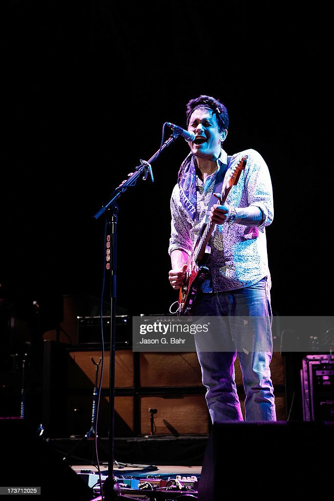John Mayer sings and plays guitar at Red Rocks Amphitheatre on July 16, 2013 in Morrison, Colorado.