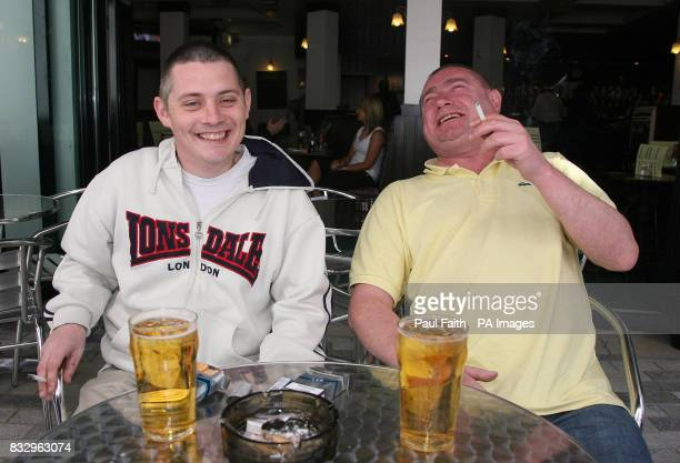 John McAdams and John Hancock enjoy a cigarette at the newly constructed beer garden at the Mermaid bar in Belfast city centre