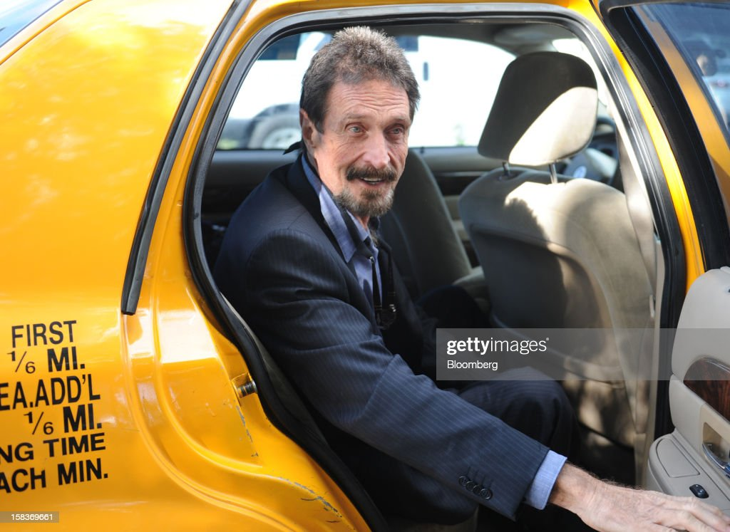 <a gi-track='captionPersonalityLinkClicked' href=/galleries/search?phrase=John+McAfee&family=editorial&specificpeople=1353446 ng-click='$event.stopPropagation()'>John McAfee</a> arrives for an interview in Miami, Florida, U.S., on Friday, Dec. 14, 2012. McAfee, who is wanted for questioning in the shooting of an American citizen in Belize, was denied asylum by Guatemala. Photographer: Louis Lanzano/Bloomberg via Getty Images