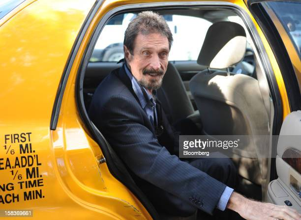 John McAfee arrives for an interview in Miami Florida US on Friday Dec 14 2012 McAfee who is wanted for questioning in the shooting of an American...