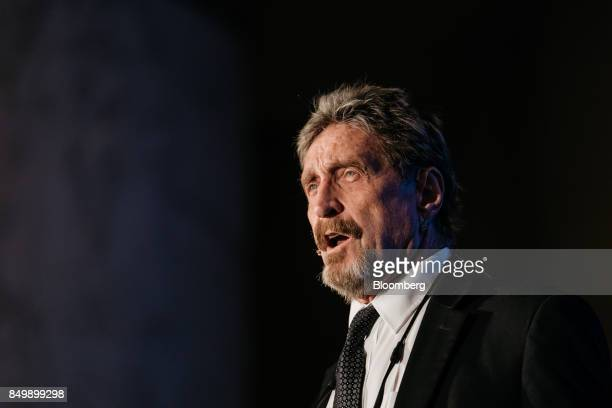 John McAfee founder of McAfee Associates Inc and chief cybersecurity visionary at MGTCapital Investments Inc speaks at the Shape the Future...